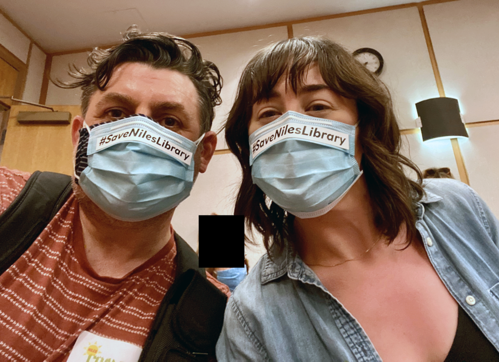 #SaveNilesLibrary Organizers taking a selfie wearing facemasks that read #save niles library.